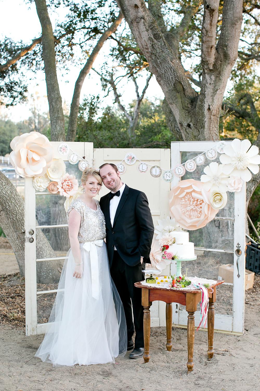 bride and groom in front of vintage doors