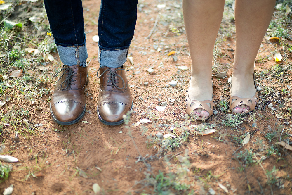 mens feet and women feet side by side