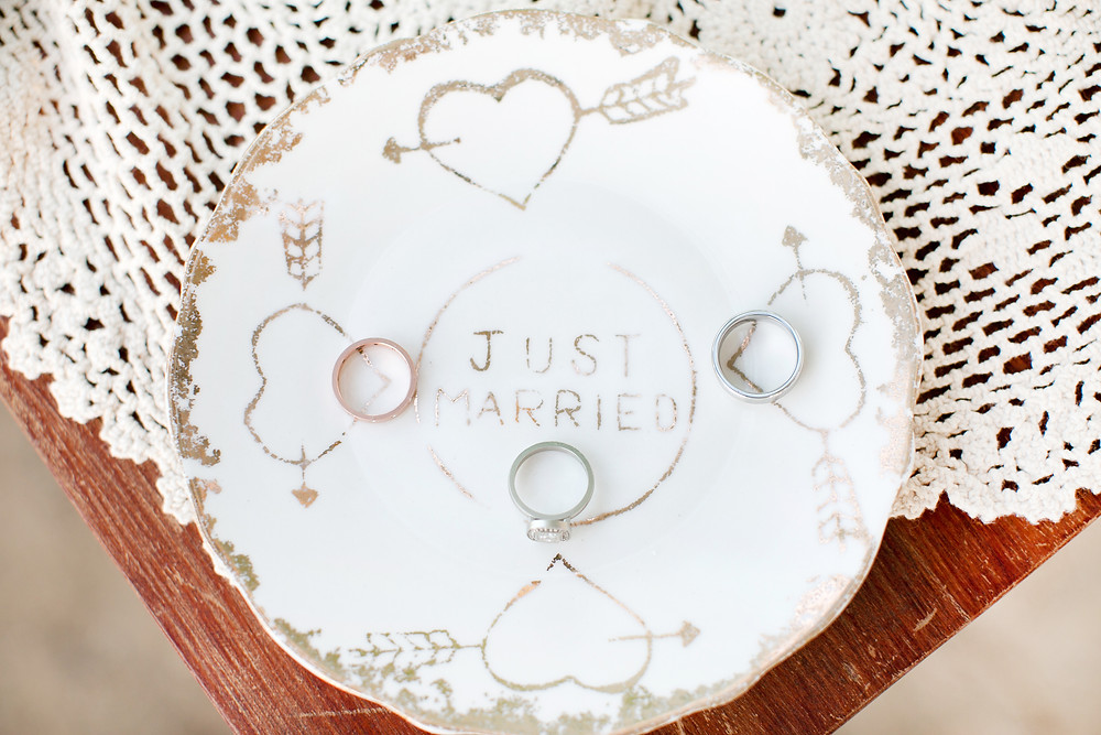 just married plates with wedding rings