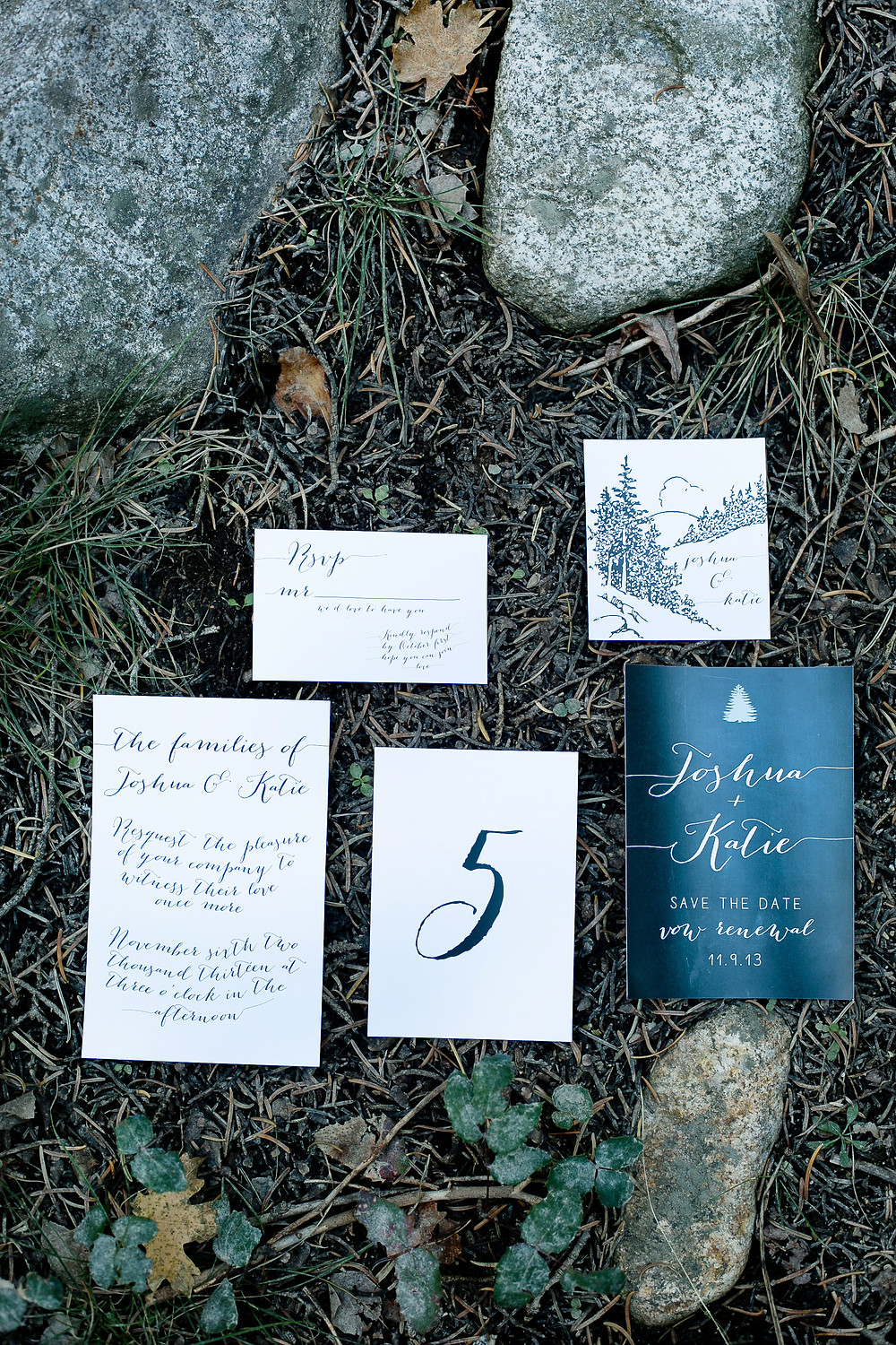 wedding suite invitation styled on forest ground