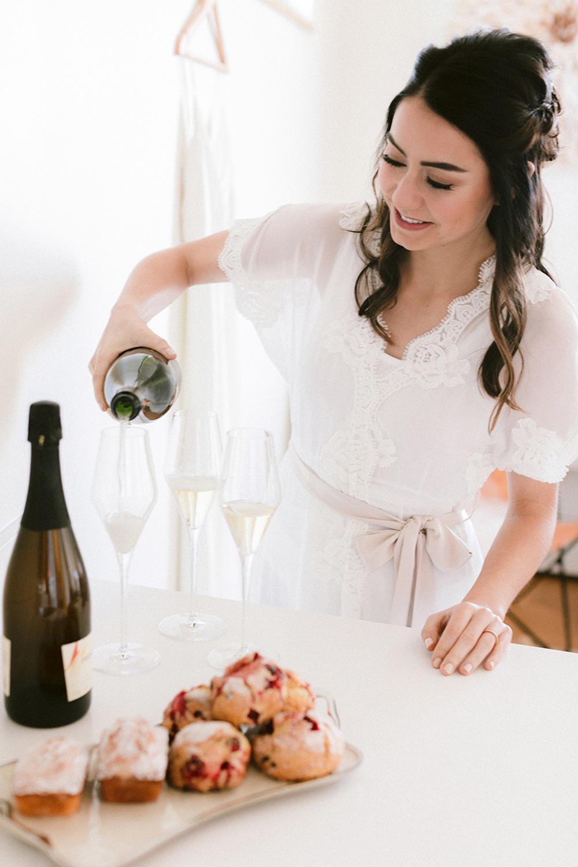 bride pouring wine