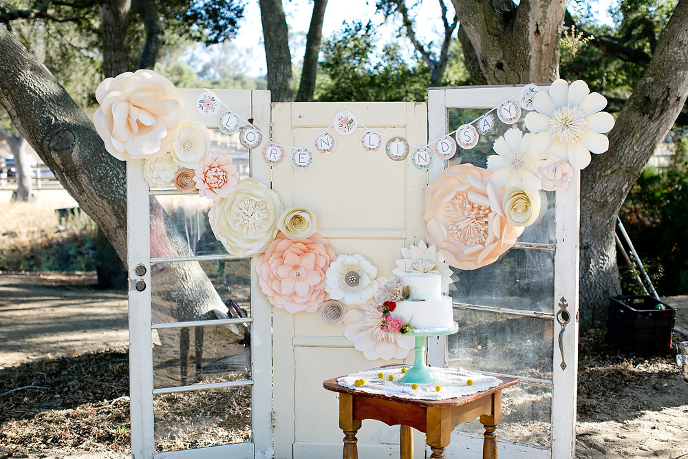 vintage french door background with paper flowers and wedding cake