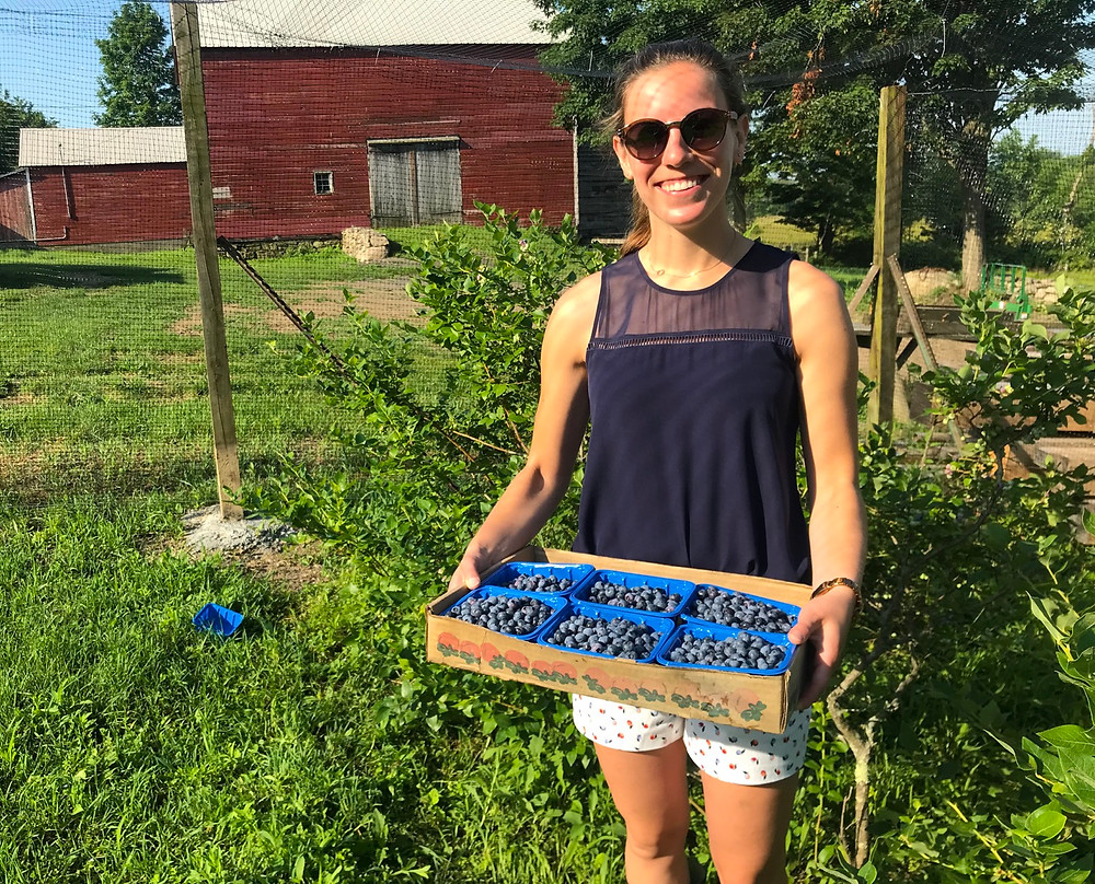 Alana, the owner of Watergrasshill B&B holding a flat of homegrown blueberries.