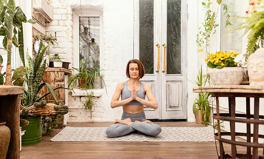 full-shot-woman-meditates-indoors.jpg