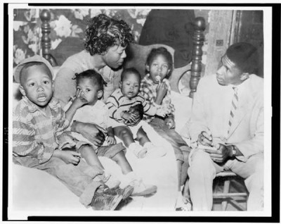 Medgar Evers is interviewing Beulah Melton about the murder of her husband, Clinton Melton, in 1955. Mrs. Melton died (likely killed) before she could testify. Click photo to learn more. This is one of many murder cases Evers investigated. Photo: Library of Congress.