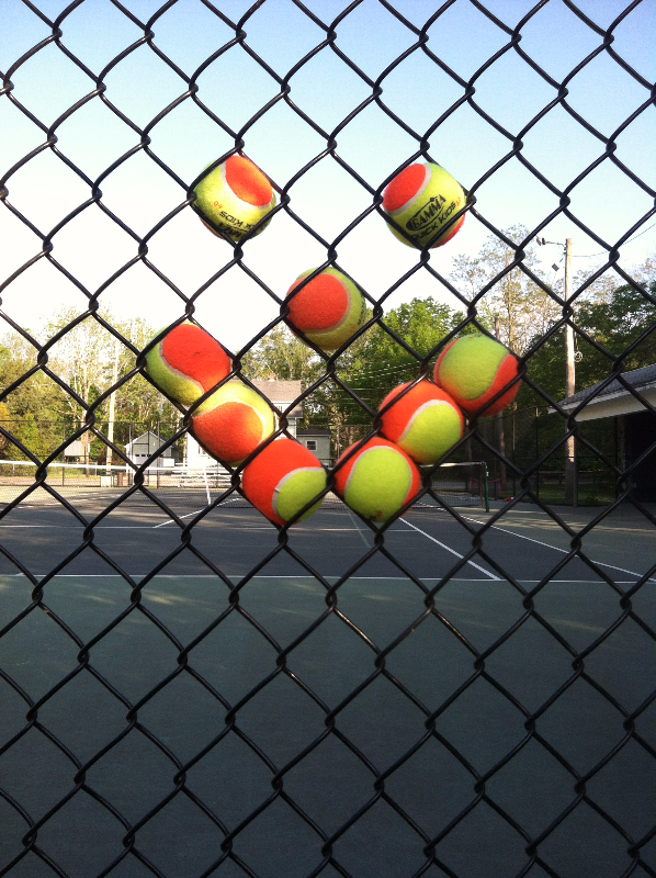 Orange tennis fence art