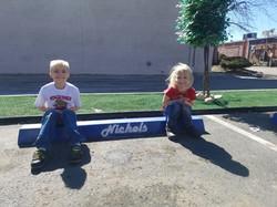Kids sitting on repair parking block