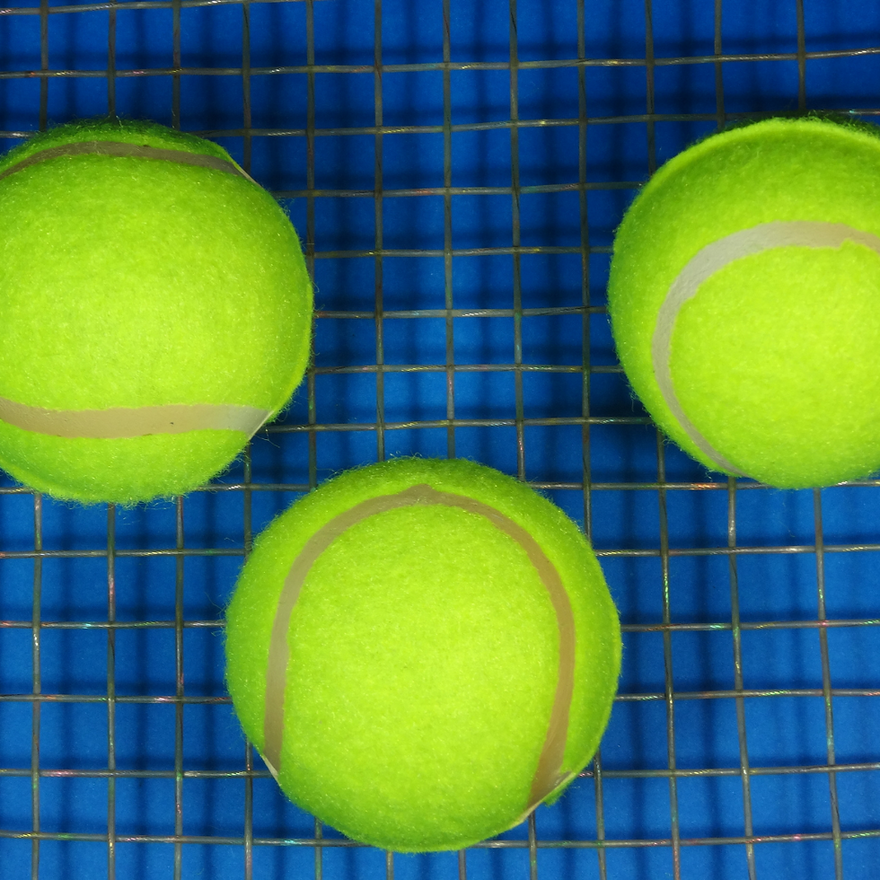 balls and racquet.png