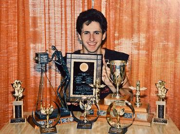 Randy with awards.jpg
