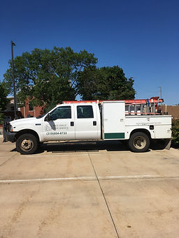 White High Angle Tree Service Work Truck Parked