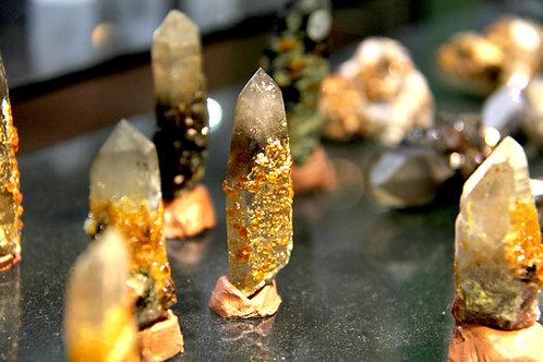 Spessartine crystals on Smokey Quartz point