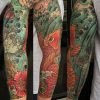 Full sleeve in Irezumi style, full color, chrysanthemum, waves, and koi, by Owen Juarez of Paper Crane Studio in Long Beach, CA.