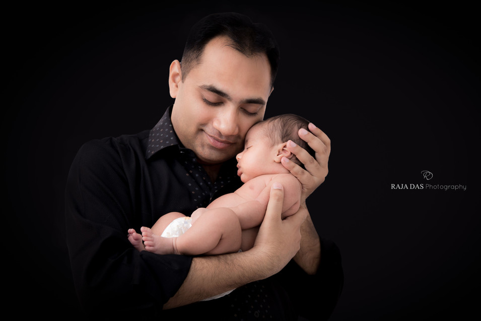 newborn baby and father photo