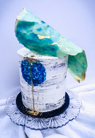 Celebration cake for a minimalist painter with a love of blue