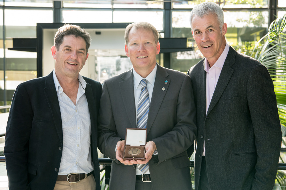 CSIRO's Dr John Kirkegaard is pictured with Delta Ag's Chris Duff and Tim Condon