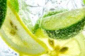 Lemon slice drop in fizzy sparkling wate