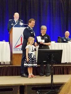 US Air Force Auxiliary-CAP Cadet Orientation Pilot Maj. Tomas Settell Receiving Award