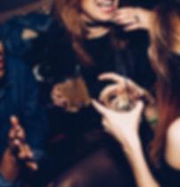 Women socialising at a ba