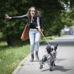 Young%20woman%20walking%20her%20dog%20on