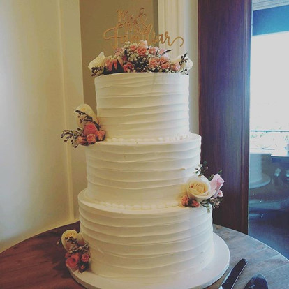 Another lovely buttercream cake adorned with fresh florals.jpg