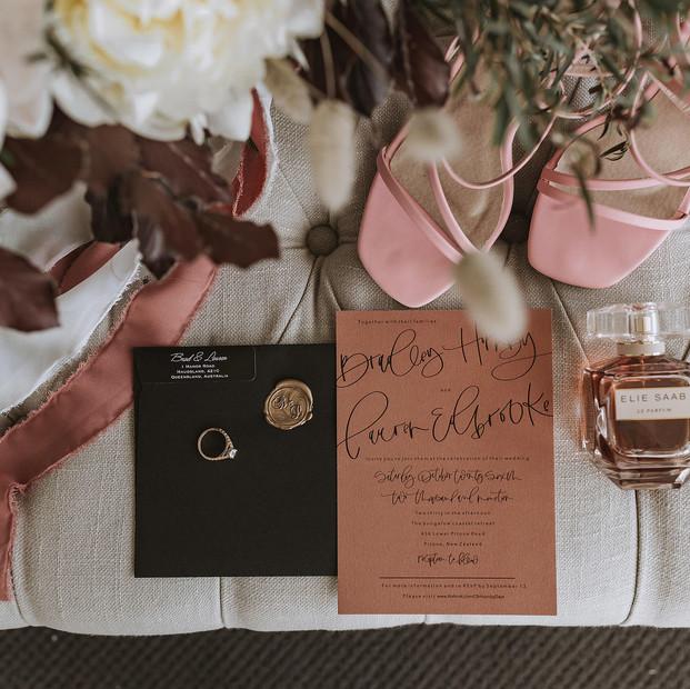 Wedding details flowers stationary perfume