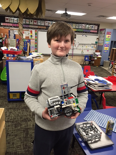 ethan with fll robot.png