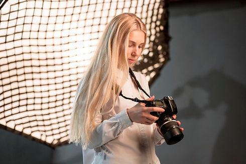 girl-studio-using-camera-photo_23-214856