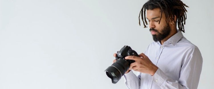 man-with-camera-copy-space_23-2148503533