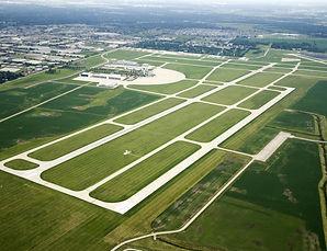Birds-eye view of green farmland.jpg