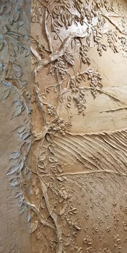 Close up carved plaster mural