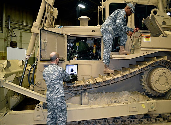 Military service technicians getting trained on equipment maintenance