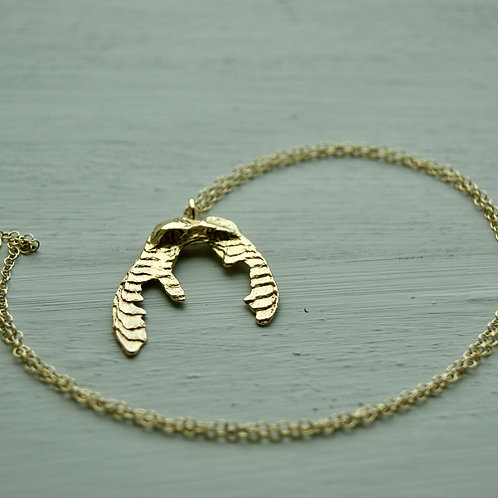 18ct gold spinner pendant on 9ct yellow chain