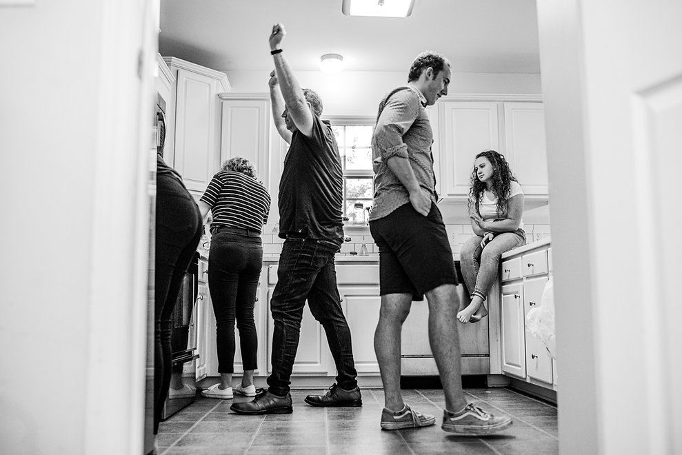 Father of 4 teenagers lifting his arms in celebration of getting the oven back into position in his Clover South Carolina home. This Day In The Life experience was shot by Jennifer of Jennifer Ann Photography