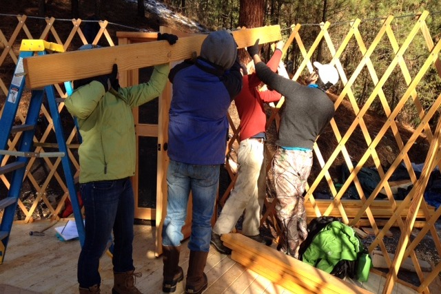Group effort to put up rafters