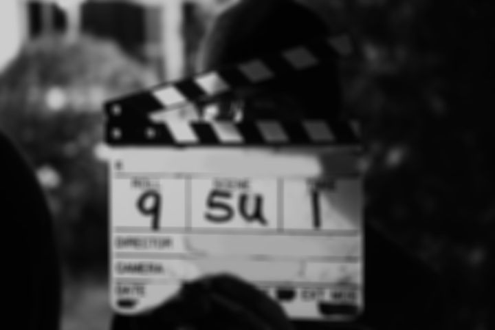 Slightly blurred image of a film slate with writing