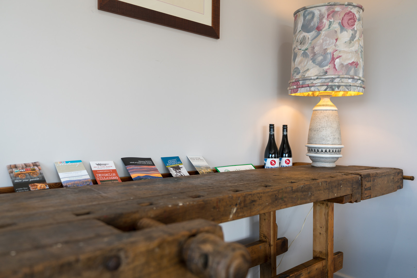 Welcome bench with local wines and visitor information