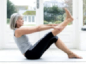 Image of a senior lady exercising at home.