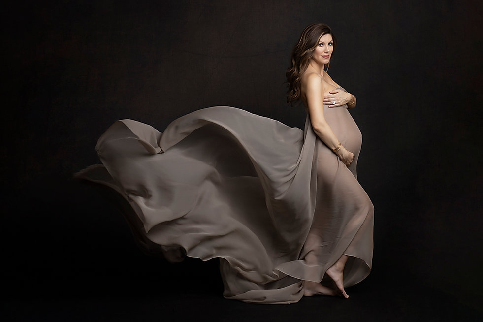 Elegant studio maternity with flying fabirc