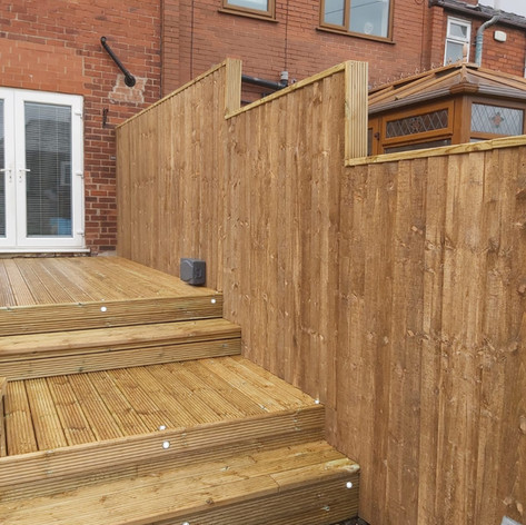 Raised timber decking with steps