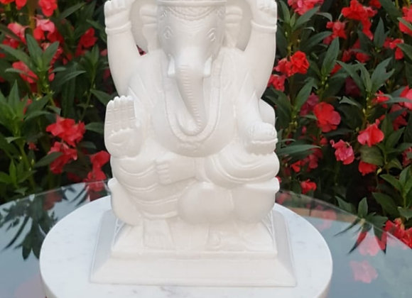 Ganesha idol with round platter and agate candle.