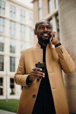 man-wearing-brown-jacket-using-smartphon