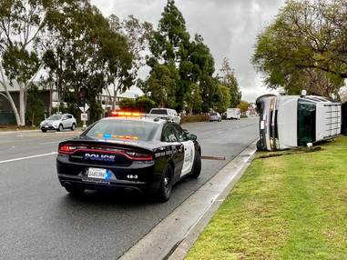 SUV Flips On Its Side in Los Alimitos, Closing Katella Ave