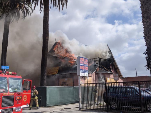 1 person taken into custody after 2-alarm house fire erupts near DTLB