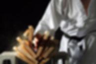 Karate Blackbelt Breaking a Stack of Boards