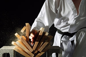 Karate Black belt Breaking a Stack of Boards