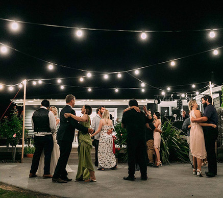 Dancing under Festoon lights