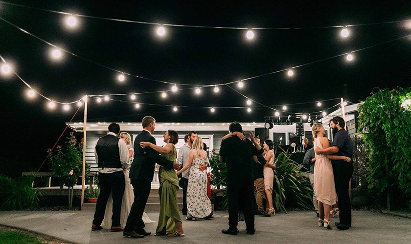 Dancing under Festoon lights