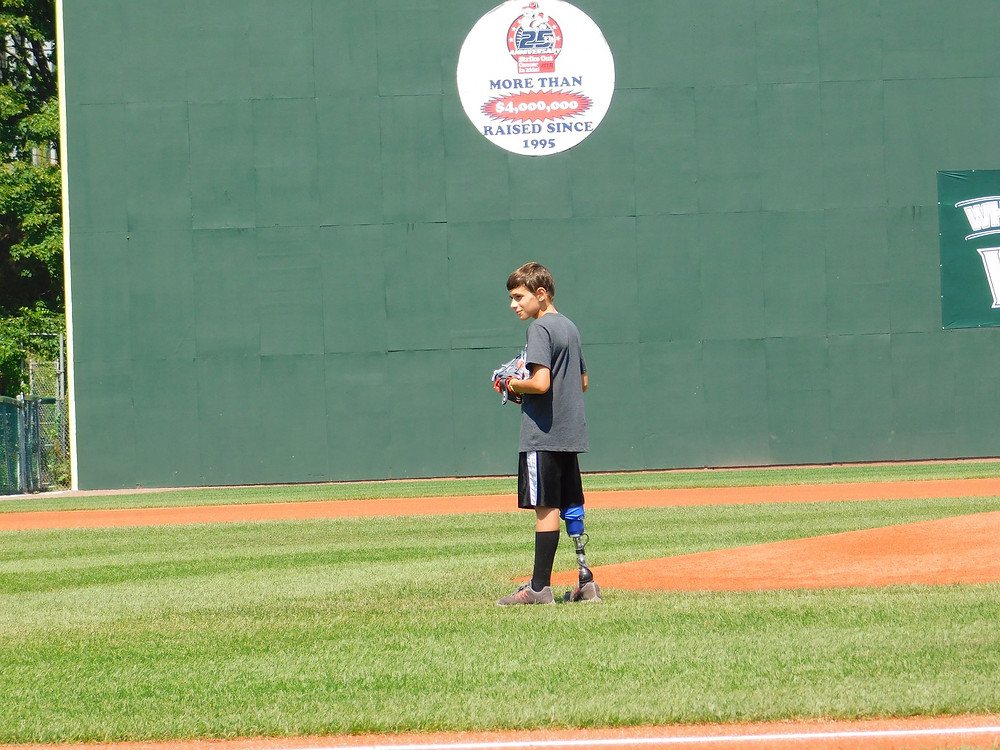 Kaleb Merola throws out the first pitch at the Portland SeaDogs game.