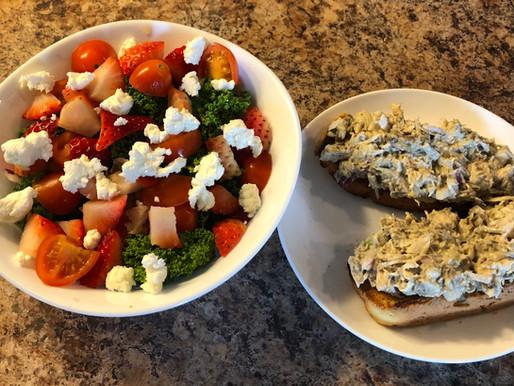 kale salad and chicken salad sandwich