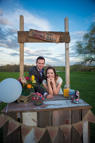 Bride and Groom in the kissing booth